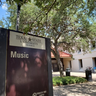 """Sign that says """"music"""" outside of the Music Building on campus."""