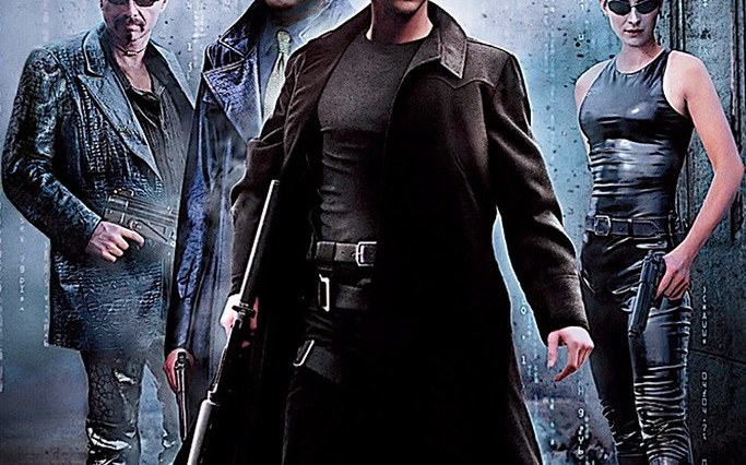 Keanu Reeves, Carrie-Ann Moss, Laurence Fishburne and Joe Pantoliano characters in The Matrix pose on the official movie poster for the movie.