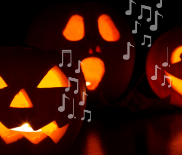 Three lit jack-o-lanterns sit against a dark background with music notes coming from their mouths.