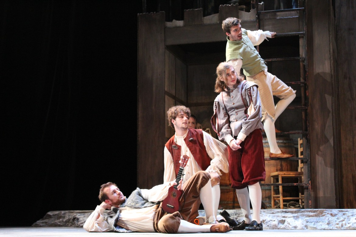 Four men wearing period pieces on stage.
