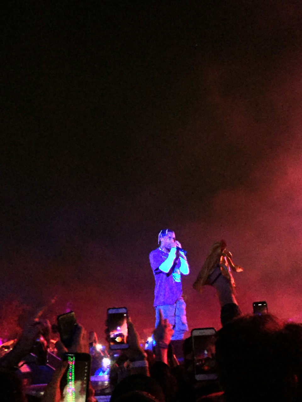The picture features Travis Scott performing during his set.
