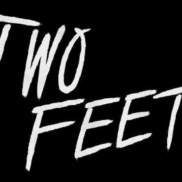 """Black background with the words """"Two Feet"""" written in white"""