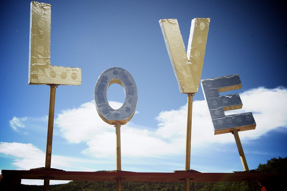 """Big letters facing towards the sky that spell out """"LOVE"""""""