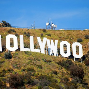 White Hollywood sign on hill