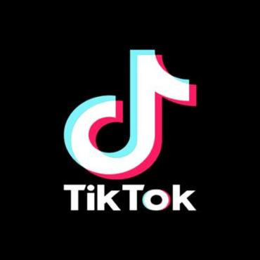 The logo for the app, TikTok. It is a black background with a colorful music note.