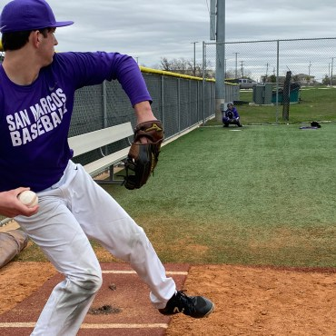 Senior right handed pitcher Gage Mason throws in the bullpen. He's about to deliver a fastball to the catcher