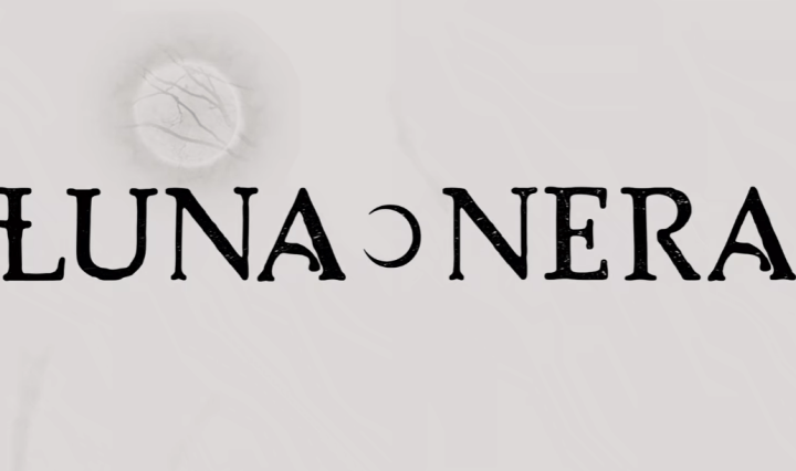 Luna Nera in black letters on a white background with a faded grey moon in the corner top of the picture.