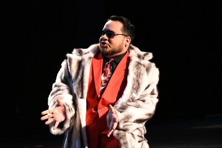 Man in fur coat with sunglasses.