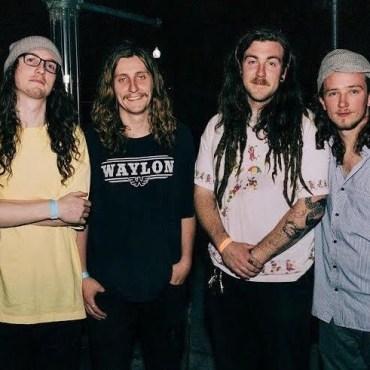 Moon Dunes band members doing cool pose outside of venue