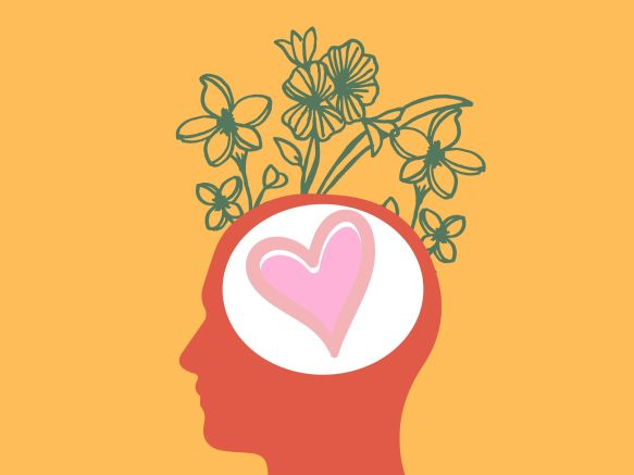 a head silhouette with a heart in the center and plants growing
