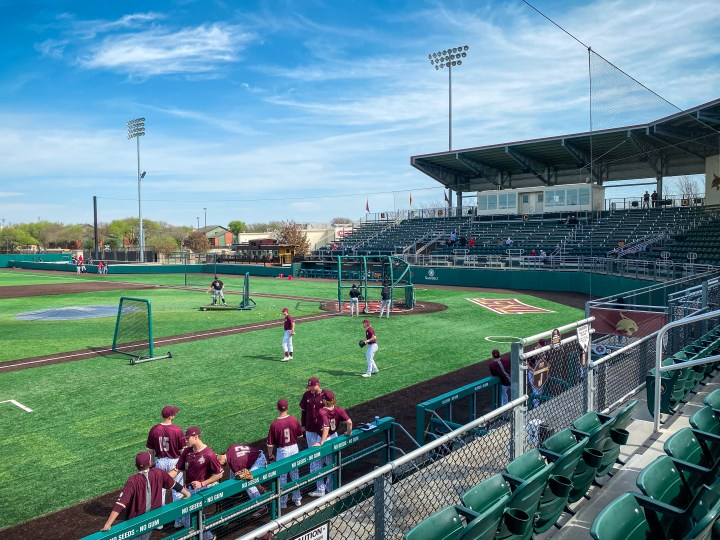 The Texas State baseball team practices under a clear sky in Bobcat Ballpark in San Marcos, Texas.