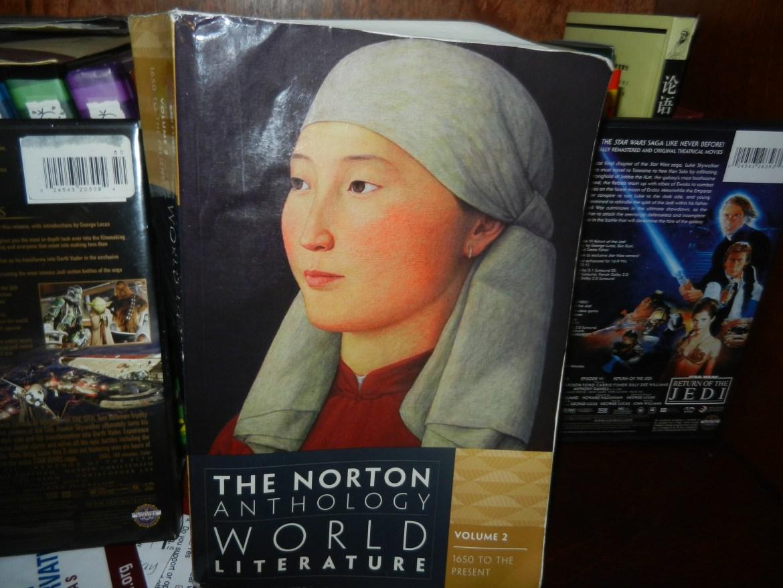 A World Literature textbook sits on a bookshelf.