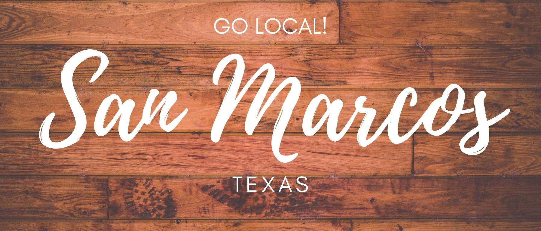 """Wooden background with white lettering saying """"Go local! San Marcos Texas"""""""