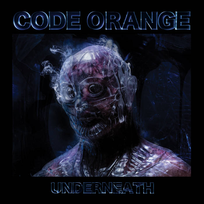 """The album cover depicts a gray humanoid monster with a mask. The top of the cover reads """"Code Orange"""" and the bottom reads """"Underneath"""""""