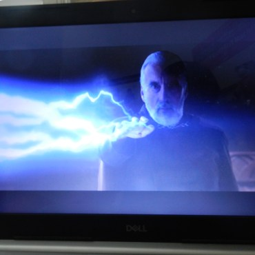 : A movie rendition of Count Dooku using force lightning in Attack of the Clones.