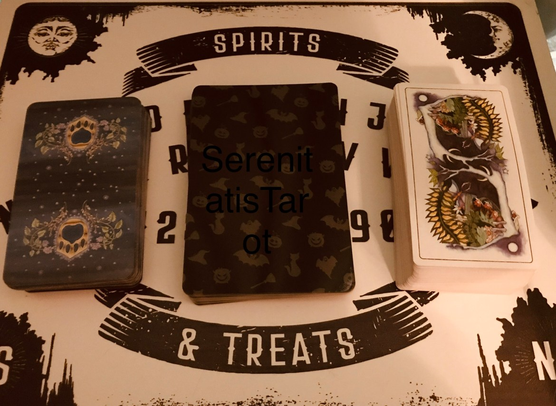 Image of three tarot card decks.