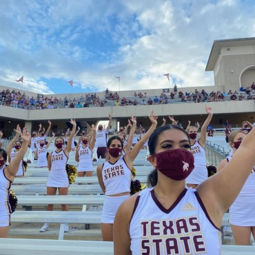 Texas State Cheerleaders lift States Up and are quiet during Texas State Football 3rd down