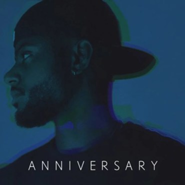 """Blue background with Bryson Tiller and the words """"Anniversary"""" on the bottom."""
