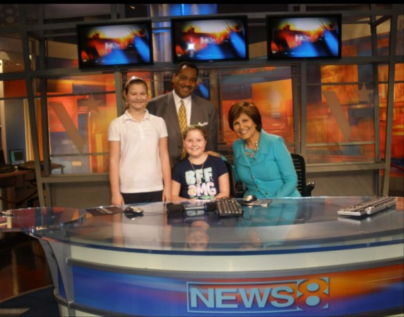 Photo of my friend and I meeting news anchors, Gloria Campos and John McCaa at the WFAA studio.