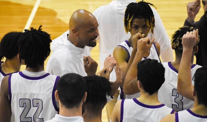 Rattlers head coach Steven Pinchback breaks out the huddle with his team during a San Marcos basketball game.