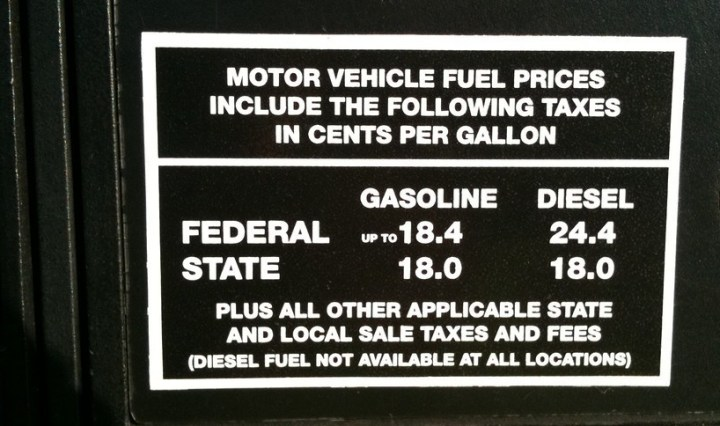 Photo showing the Federal Gasoline Tax up to 18.4 cents per gallon for gas and 24.4 cents per gallon for diesel. Photo shows state gasoline tax at 18.0 cents per gallon and 18.0 cents per gallon for diesel.