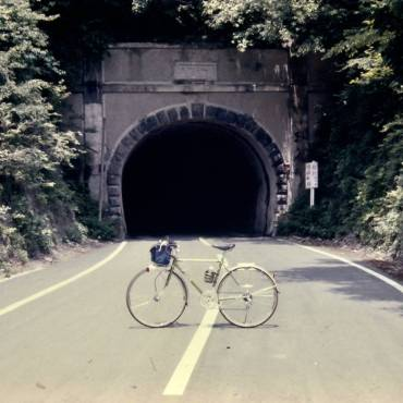 The album cover is a picture of a bike placed in the middle of the street in front of a tunnel