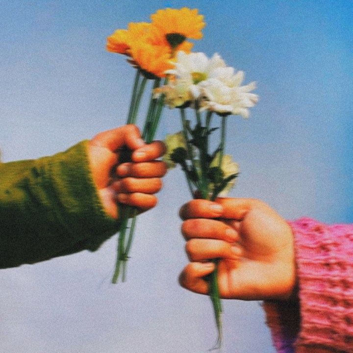 """""""Dream of Eros"""" EP cover art by Martin Delgado, an image of two hands holding flowers."""