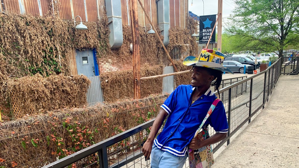 Alain Gakwaya is depicted wearing his custom designed cowboy hat at The Blue Star Arts Complex