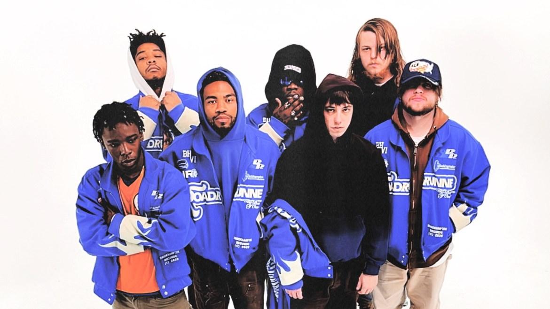 Photo of members of BROCKHAMPTON in matching blue hoodies.
