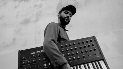 Stones throw artist Kiefer Shackelford holding a synthesizer