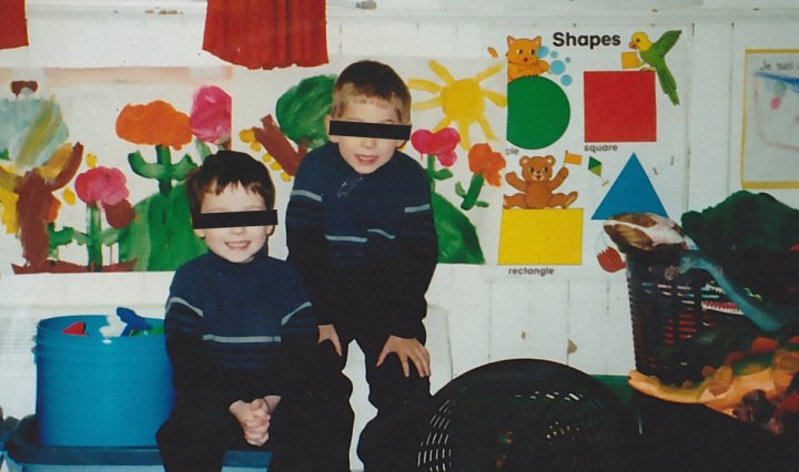 Cleopatrick band members, at the age of 8 in their elementary classroom. Their eyes are blacked out.