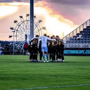 Austin Bold FC huddling