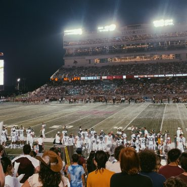Fans cheering on the Texas State Bobcats at a home game.