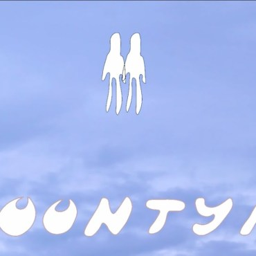 """The art is a blue background with white figures over it and white text saying """"Moontype"""""""