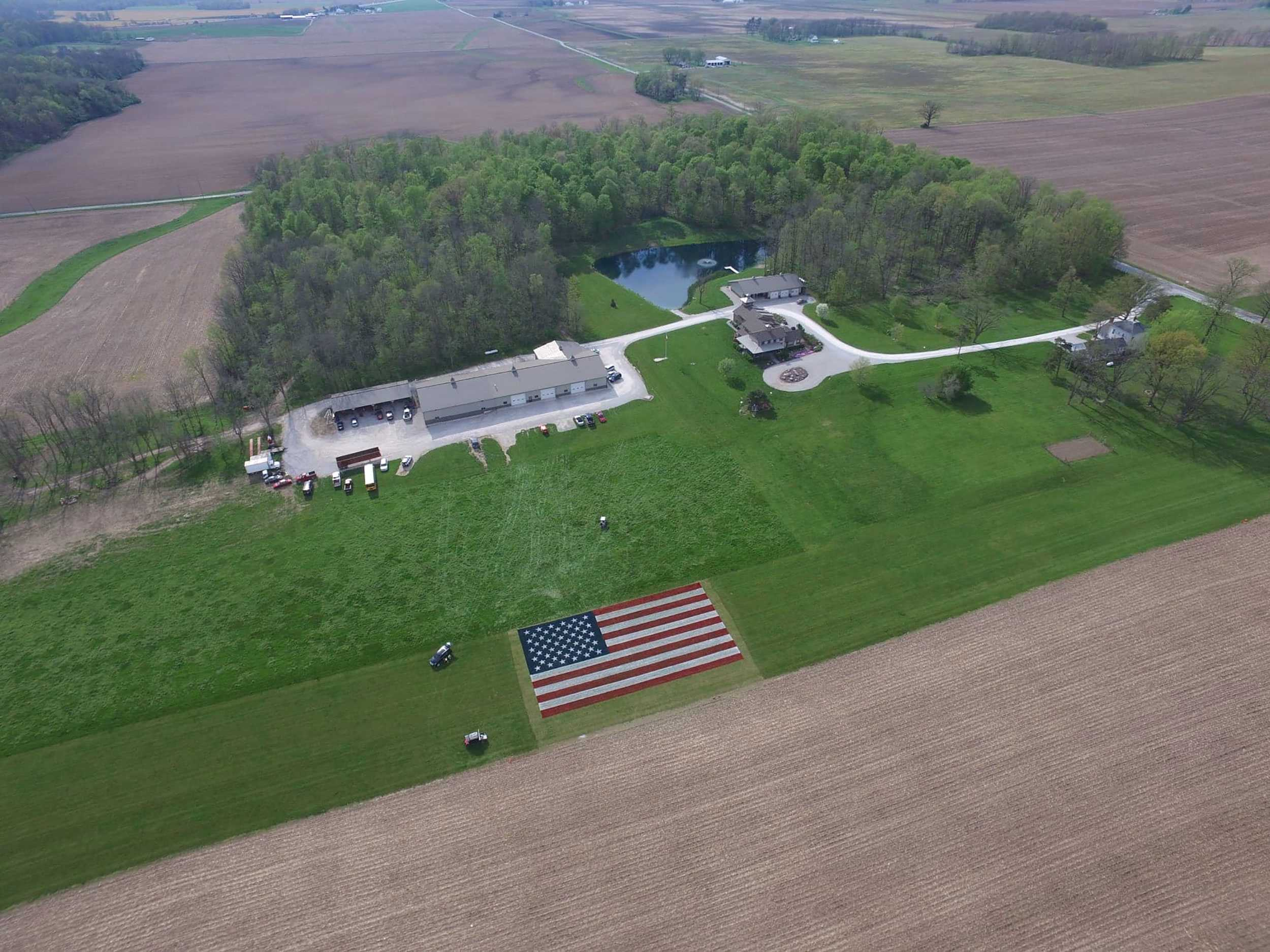 american flag painted in indiana field to honor heroes of pandemic