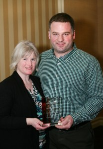 Martha and Neil Kudrinko accept an Outstanding Independent, Greatness in Green Award from Progressive Grocer at the National Grocer's Association show in Las Vegas recently.