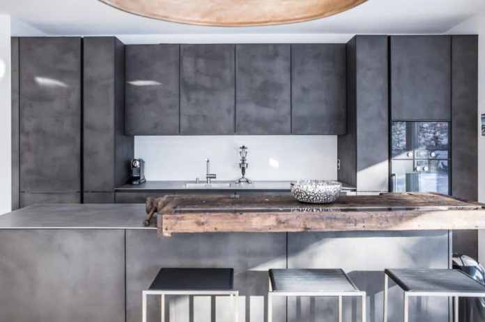 """selektionD kitchens always offer a little more: innovation, design and creative ideas.  (Model: """"Elegant coolness"""", concrete-filled fronts, worktop made of hot-rolled stainless steel, old workbench as a counter.  Photo: selektionD)"""