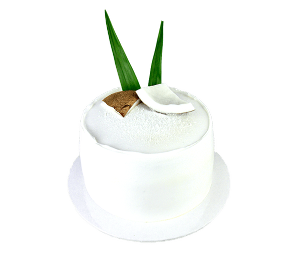 Japanese pandan cheesecake with fresh coconut flesh and coconut whipped cream frosting