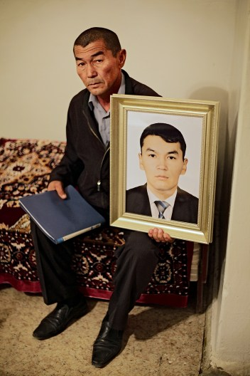 LOSS: Shetpe is a small town in the middle of a desert, 150 kilometers to northwest from Zhanaozen. Zhanibek Tolegenov, 55, is holding a picture of his son who died by police bullets. Day afer the massacre in Zhanaozen, special force police opened fire against civilians in a train station at Shetpe. Torebek Tolegenov, 30, was a firefghter, who tried to calm the riot police to not to use weapons against civilians. Shootings lasted in from a midday till late night. Zhanibek Tolegenov got hits in his car too while he was urging to a hospital where his son died for several injuries.