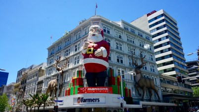 Every year an 18 metre tall Santa is pieced together and bolted to the front of the Farmers Building on Queen Street.