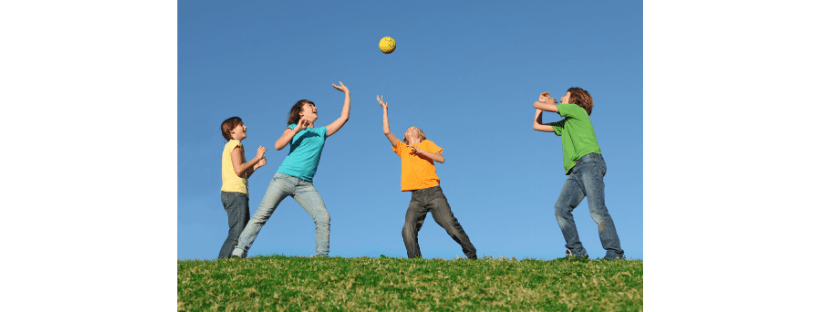 kids playing group games with a ball