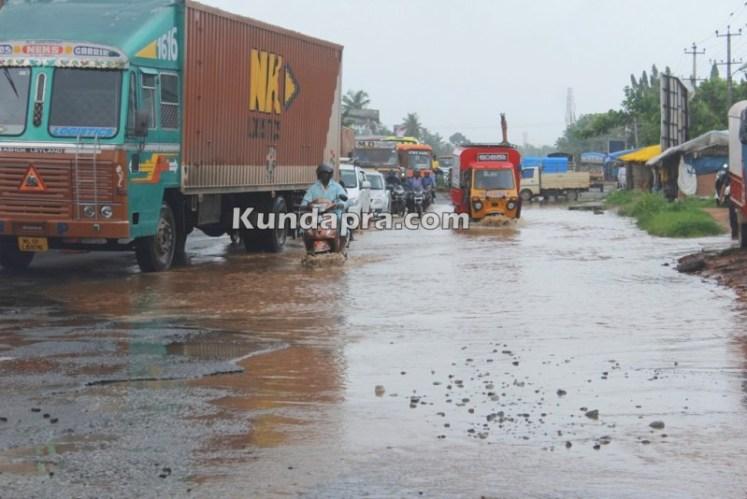 drainage water flow over road due to rain near shashri circle (3)
