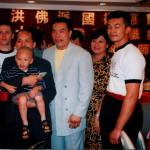 Carter smiles with Sifu John Yip and friends