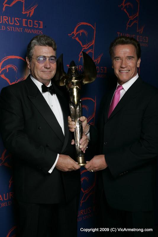 Receiving the Taurus Award from Arnie