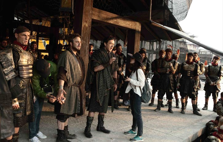 Jenny helping direct a scene on Dragon Blade
