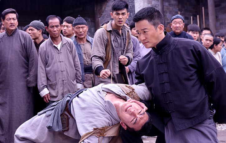 Cheung restrains an adversary