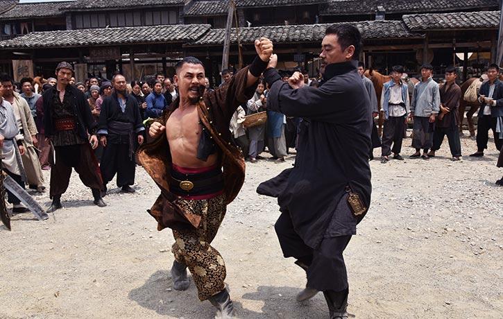 Yeung deflects Wong's punch