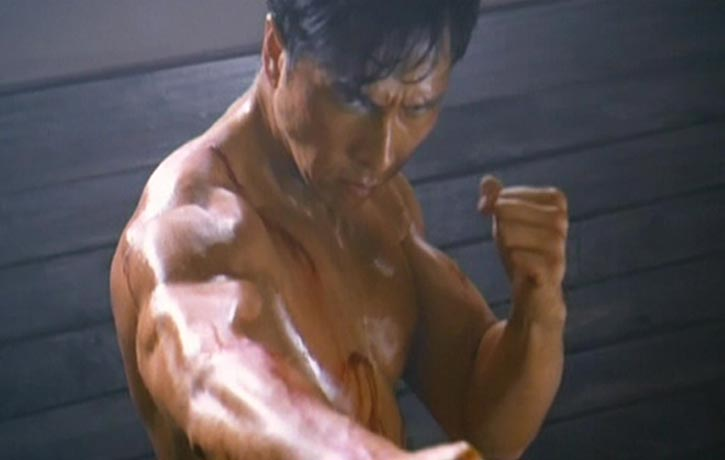 Donnie bursts into full-on, fist-clenching, cat-screeching Bruce Lee mode!