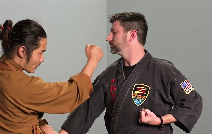 Shifu Wang demonstrates a counter-attack to an incoming strike