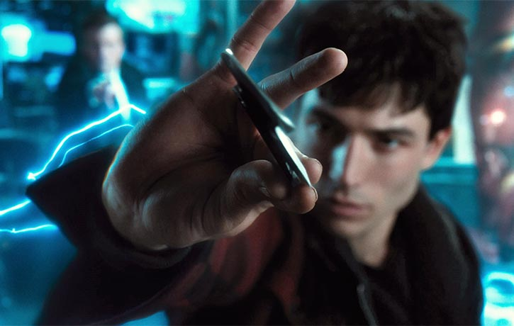Barry catches Bruce's Batarang with lightning reflexes!